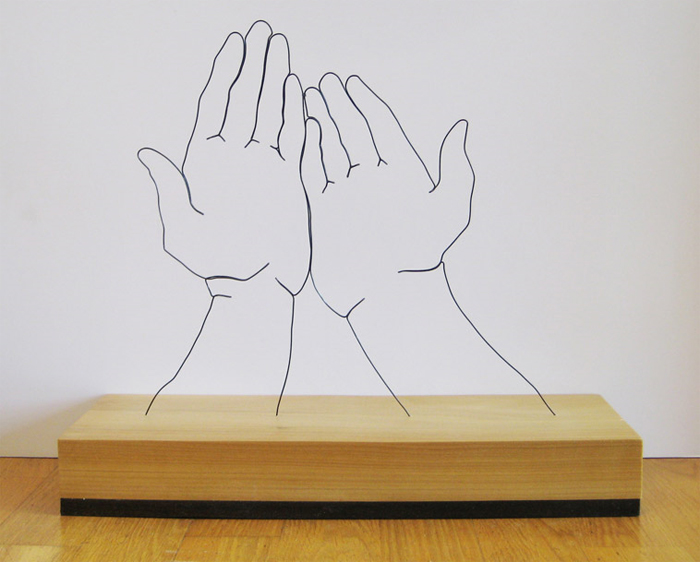 """Hands Supplicated"" wire sculpture"