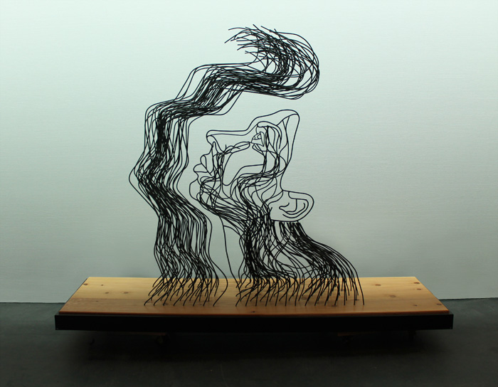 """And Light Fell On Her Face Through Heavy Darkness"" wire sculpture, front view"
